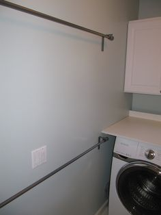 everyday organizing: Laundry  -----Curtain rods to hang clothes to dry