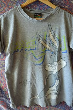 Thin, soft, well-worn 1996 Space Jam T-shirt with Bugs Bunny on the front. Both…