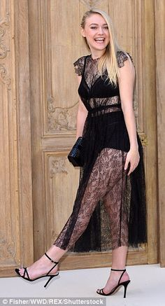 Dakota Fanning flashes her lingerie in totally sheer lace gown