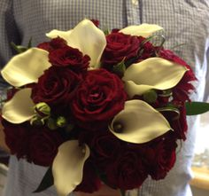 Bridal Bouquet of Deep Red Roses and White Calla Lilies.