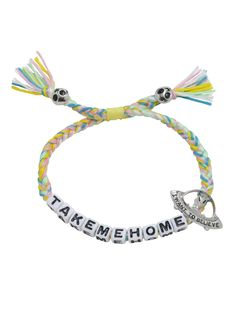 "<div>Always be ready with an SOS in case you spot a UFO to take you home! This blue, white, pastel pink, and green braid bracelet from Blackheart has ""Take Me Home"" in block letters, silver-tone UFO charm etched with ""I Want To Believe,"" and alien face charms at tasseled ends. </div><div><ul><li style=""list-style-position: inside !important; list-style-type: disc !important"">Alloy charms</..."