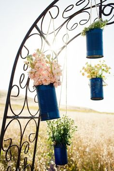 Can Vases. Cute pop of blue with white flowers.