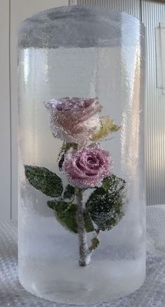 A pink rose frozen in ice make the perfect table center piece by www.psdiceart.co.uk