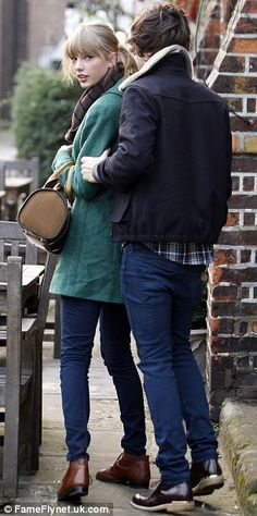 it looks like he is grabbing her arm and pulling her away from the cameras i hated Haylor so much its like fried chicken and ice cream everybody loves them but not together it needed to end it was literally the worst thing that has happened in the fandom so far :/
