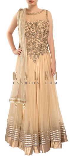 Buy Online from the link below. We ship worldwide (Free Shipping over US$100) http://www.kalkifashion.com/beige-anarkali-suit-adorn-in-zari-and-kundan-embroidery-only-on-kalki.html