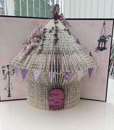 Book folding fairies house