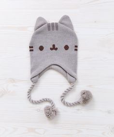 Stay warm in this super cozy Pusheen knitted hat, featuring adorable Pusheen details and two pom pom ties. Available at Pusheen Shop! Pusheen Toys, Gato Pusheen, Pusheen Shop, Pusheen Cute, Pusheen Birthday, Cat Toilet Training, Kawaii Plush, Cute Hats, Kawaii Clothes