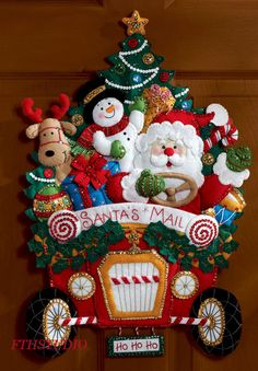 The Bucilla Christmas Mail Truck Wall Hanging Kit is from Bucilla's Seasonal Home Decor' line of products. This three dimensional, felt applique Mail Truck Wall Hanging Kit features Santa driving a mail truck with a snowman and reindeer tagging along. Christmas Mail, Christmas Time, Christmas Stockings, Christmas Wreaths, Christmas Crafts, Christmas Decorations, Christmas Ornaments, Plaid Christmas, Holiday Decorating