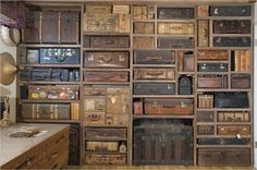 Suitcases   Old luggage wall/design feature.  Hope it is used for storage.