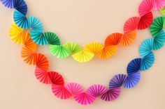 Rainbow Fan Garland: Use rainbow coloured copy paper, cut into squares. Accordion pleat each piece, then fold in half, then tape centre together. Tape sequential colours together in alternate directions. | Ice Cream Off Paper Plates