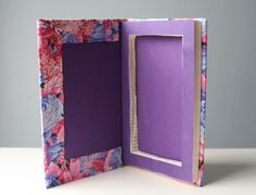 DIY: Book Safe - Love the idea for phone charging station, this blog shows how to cut the hole in the book. Very clever!
