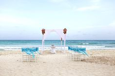 The blue bows added to the chairs really complement the ocean hues #NowJadeRivieraCancun #Mexico #DestinationWedding photo credit: delsolphotography.com