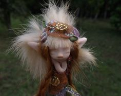 Sweet pixie fairy girl is a full sculpt ooak Her hair is mohair She sits just under 3inches hope you enjoy her thank you for looking post includes registered post to overseas and express post to aussies much love and fairie blessings kerrie