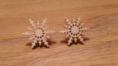 Wooden snowflakes  https://www.etsy.com/uk/listing/253308156/unique-wooden-seasonal-snowflake