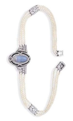 AN ART DECO MOONSTONE INTAGLIO, DIAMOND AND SEED PEARL NECKLACEBROOCH, BY HARDY & HAYES CO. The detachable oval moonstone intaglio, onyx and diamond centre flanked by articulated diamond geometric panels to the seed pearl three-row necklace with square openwork diamond links and clasp, centre detaches to form a brooch, circa 1920, signed H & H Co. for Hardy & Hayes.♥•♥•♥