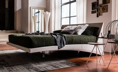 The Dylan Bed is a modern angular leather bed  with chromed steel feet from IQ Furniture.