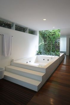 This beautiful bath has steps leading up to the bath. This is perfect if you struggle to get into taller baths and it also gives you a handy seating area.