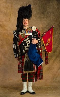 Pipe Major Mark MacRae of the 1st Btn. Scots Guards.