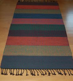 This hand woven rug would fit well in places like entryways, kitchens, etc. Denim Tote Bags, Textiles, Striped Rug, Tapestry Weaving, Make Design, Woven Rug, Rugs On Carpet, Rag Rugs, Totes
