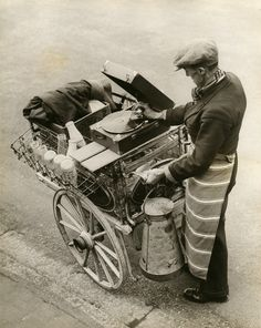 """A Musical Milkman . This music certainly does go round and arund, for this Kentish milkman apparently has an ear for music and so carries a portable gramaphone on his milk waggon [.sic] to brighten up his daily work. Old Pictures, Old Photos, Vintage Photos, Rare Photos, Wayne Miller, Inge Morath, Musica Disco, Vinyl Junkies, Vintage Photography"