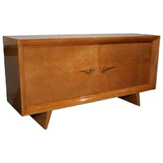 Sycamore Two-Door Cabinet by Suzanne Guiguichon, French 1937   From a unique collection of antique and modern cabinets at https://www.1stdibs.com/furniture/storage-case-pieces/cabinets/