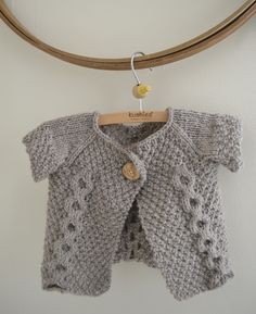 Sizes  Sizes: 3 months, (6 months, 12 months, 18 months, 24 months) Finished chest  measurement: 19.5 (20.5, 21.5, 22.5, 23.5) inches, buttoned. Sweater is  designed to be worn with about 2-3 inches of positive ease.    Yarn  Aran or Bulky weight yarn such as Cascade Yarns Eco Wool (pictured) or  Quince & Co. Osprey    Yardage  200-300 yards    Needles  US 8 24 inch circular needle, or size needed to obtain gauge  US 8 DPNs for sleeve    Notions  Markers  Stitch holders or scrap yarn…