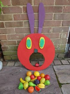 HUGE Very Hungry Caterpillar Ideas for your Setting- Very Hungry Caterpillar fruit in mouth game