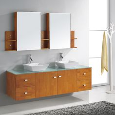 Add a modern feel to your bathroom with this double sink vanity set by Virtu. Featuring beautiful sold oak wood and brush nickle hardware, this lovely set includes soft closing drawers, two pre-drilled faucet mounts and two medicine cabinet style mirrors.