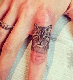 Finger cat tattoo