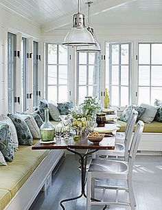 Dining banquette in front of windows