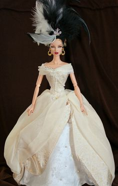 https://flic.kr/p/9PLj4z   Lady  Camille   In  Full  Regalia  Eugenia  Perrin  Frost  is  modeling  a  gown  by  Lady  Camille  barbie  2002.  It's  the  2nd  series  from  The  Portrait  Collection.    Her  headdress  is  from  the  Illusion  barbie....