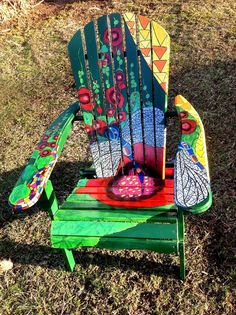 Dragonfly and hollyhock painted adirondack chair.