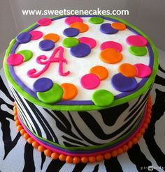 Halloween Birthday Cake with a bit of zebra, theme similar to evite invitation with the circles