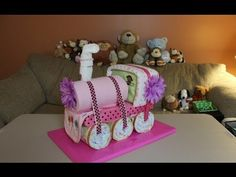 Choo Choo Train Diaper Cake (How To Make)    Another Fun Diaper Cake video Tutorial: ) In this video I show you how to make a cute Choo Choo Train Diaper Cake! Just another fun way you can show your friends or family how much you care at the next Baby Shower.     Thanks so much for watching, please subscribe so you don't miss any future videos!    Cho...