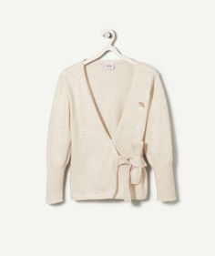 """CARDIGAN GINGER :                     This crossover cardigan will look lovely on your little poppet and give her a chic look!             MARL CARDIGAN, V-neck, fastens with a bow, long sleeves, """"diamond"""""""