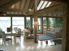 Living upstairs in a green oak frame with sea views