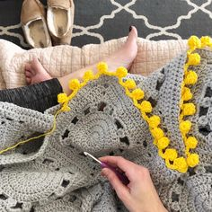 "Crochet blanket with pom pom edging #crochet #pompom #grey #yellow   399 Likes, 37 Comments - Lindsay (@lindsay_lou_crochet) on Instagram: ""Putting on the (very adorable!) finishing touches.  . . . #crochetblanket #craftsposure…"""