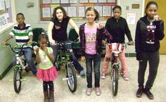 Fifty-Third Street School held its first annual attendance lottery this year. Students who maintained an attendance rate of 95% or higher over the course of the semester were eligible. Students had an opportunity to win one of three brand new bikes donated by the school P.T.O., State Farm Insurance and New Beginnings are Possible. Other prizes were also raffled to promote good attendance. Check out the winners with their bicycles and other prizes!