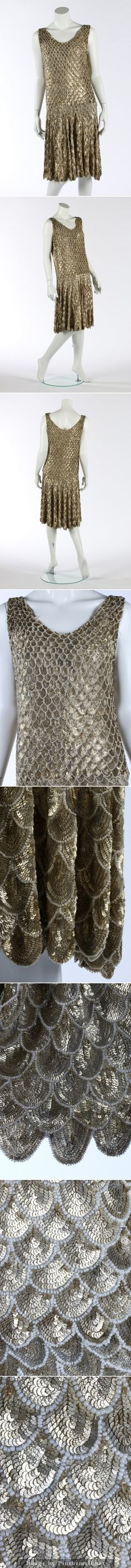 A fine couture gold sequined 'flapper' dress, circa 1927. un-labelled, the tulle ground applied with embossed golden sequined scales edged in pearl beads, which increase in size from neck to hem. KTA