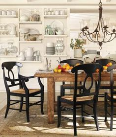 mix of rustic table with chairs.