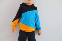It's hoodie time of the year! Let your kid feel cool, cozy and comfortable in a nice sweatshirt or dress with a hood or wide collar.