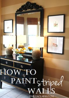How to Paint Striped Walls  http://emilyaclark.blogspot.com/2010/07/lessons-in-painting-striped-walls.html