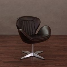 Luxurious vintage tobacco leather featuring a light natural embossing covers this timeless piece of extraordinary furniture, bringing comfort and style to any setting. Enhance your home or office decor with the retro styling of this swivel chair.