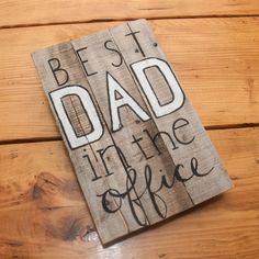 """Best dad in the office Rustic office sign Rustic office decor Wood office decor Custom office decor Gifts for dad Custom gifts for dad. • Handcrafted and painted by North Carolina artisans • Created with naturally distressed, reclaimed wood • Provides a wooden wall hanging for dad's office • Dimensions: 13"""" x 11"""" *This item is made to order. Variations in color and the number of boards used may occur depending on the wood available. Please contact us if you have specific requirements...."""