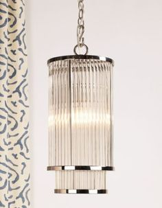 This ceiling light reflects the ethos of modern style, with its clean lines and understated elegance. Individual glass rods cascade from a circular frame to create a truly refined fixture. Wall Lights, Ceiling Lights, Lighting Design, Spotlight, Sconces, Chandelier, Elegant, Glass, Frame