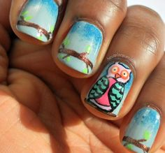 super cute polychrome owl sitting on a branch against a blue sky gradient manicure