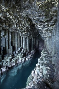 "(""FINGAL's CAVE"") .... on the island of Staffa off the west coast of Scotland (near Mull and Iona), is a sea cave formed within Tertiary basalt lava flows which have cooled to form hexagonal columns."