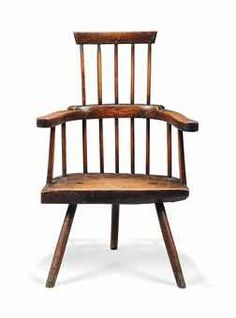 A GEORGE III ASH THREE-LEGGED WINDSOR ARMCHAIR  LATE 18TH CENTURY, WELSH  With three-part armbow and solid slab seat  40 in. (102 cm.) high; 16½ in. (42 cm.) seat height; 24 in. (61 cm.) wide
