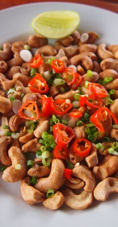 Lao food. cashews with fresh chili, spring onion and a squeeze of lime. Great with a Beer Lao! Our 6 weeks in Laos last year, we fell in love with the country and her people, come and read more on the blog. http://worldtravelfamily.com #food