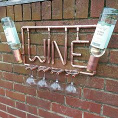 Check out this item in my Etsy shop https://www.etsy.com/uk/listing/539097516/funky-copper-wine-rack-and-glass-holder
